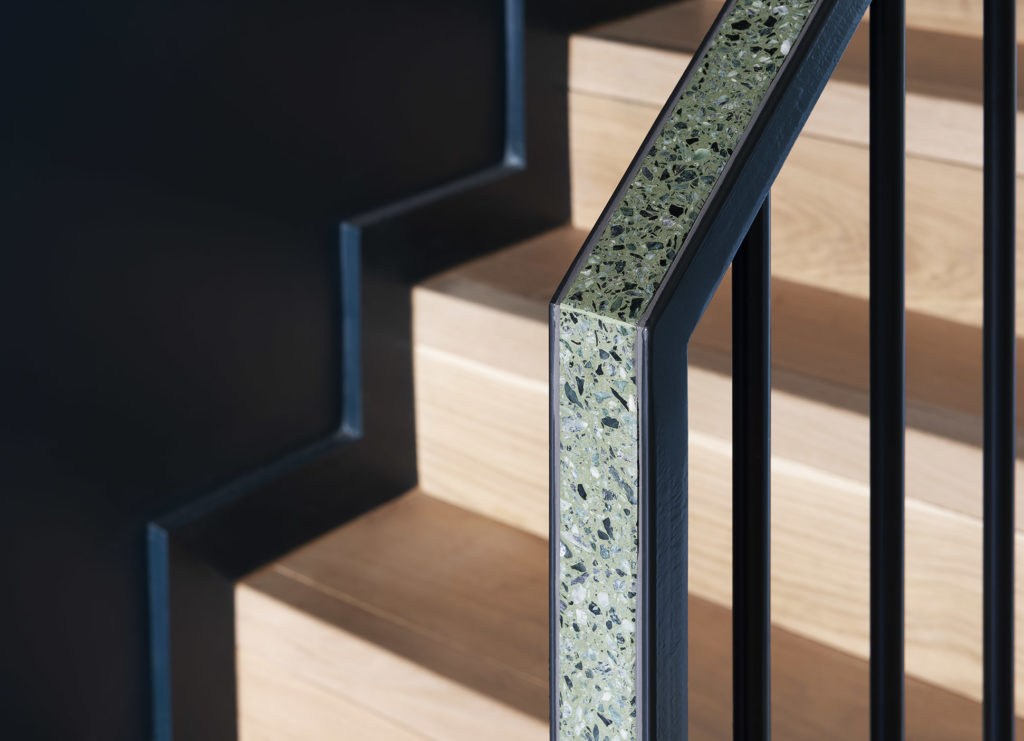 his project embraces the pluripotent applications of terrazzo in contemporary architecture, employing it for the floors, kitchen island, bathroom backsplash, and even in the staircase handrail.