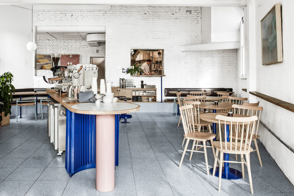 Powder blue terrazzo floors coat the floor of Mammoth, an Australian café inspired by, among other things, holiday vibes and Wes Anderson