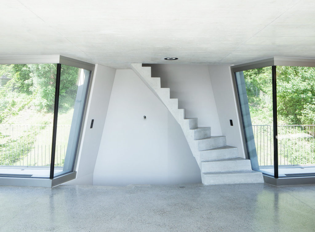 Neutral grey terrazzo floors are used throughout the entire build.